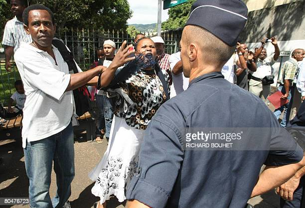 People demonstrate against ousted Anjouan leader Mohamed Bacar and his supporters upon their arrival on April 2 2008 at the administrative court of...