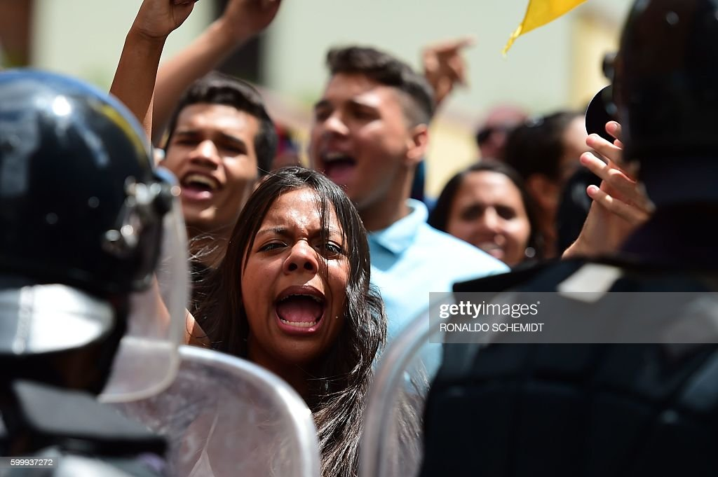 People demonstrate against President Nicolas Maduro, in Los Teques, Miranda State, Venezuela, on September 7, 2016 as the country's opposition called for new nationwide protests to pressure for a referendum on removing him from power by the end of the year. Venezuela's opposition is holding nationwide protests against Maduro, testing his grip on power six days after massive demonstrations showed the magnitude of anger over a raging crisis. / AFP / RONALDO