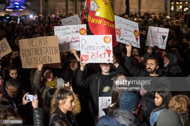 People demonstrate against racism after a vigil for the vicitms near the Midnight shisha bar, one of the sites of last night's shootings, on February...