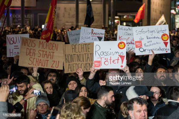 People demonstrate against racism after a vigil for the victims near the Midnight shisha bar, one of the sites of last night's shootings, on February...