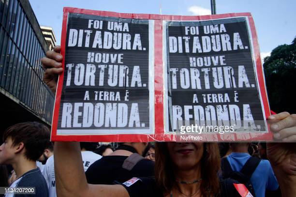People demonstrate against the 1964-1985 dictatorship on the 55th anniversary of the coup, in Sao Paulo, Brazil, on March 31, 2019. - Hundreds of...