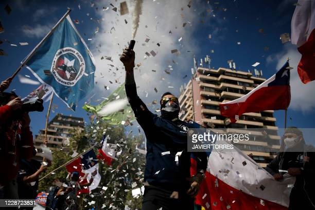 People demonstrate against the amendment of the constitution established under the military rule of General Augusto Pinochet , which will be voted in...