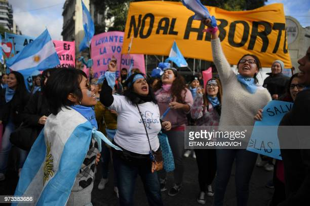 People demonstrate against the approval of a bill that would legalize abortion in front of the Argentine Congress in Buenos Aires on June 13 2018...
