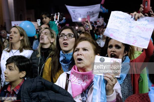 People demonstrate against the decriminalization of abortion in front of the Cathedral of Tucuman in northern Argentina after marching under the...