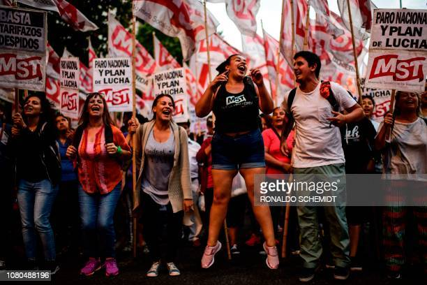 People demonstrate against the economic measures of the government of Argentine President Mauricio Macri, in Buenos Aires, on January 10, 2019. -...