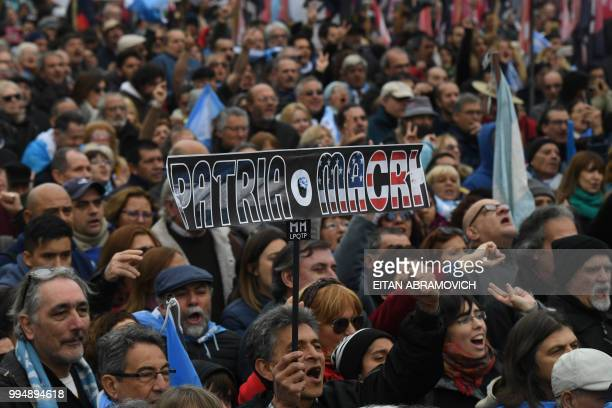 People demonstrate against the government of President Mauricio Macri and the latest deal with the International Monetary Fund during the 202th...