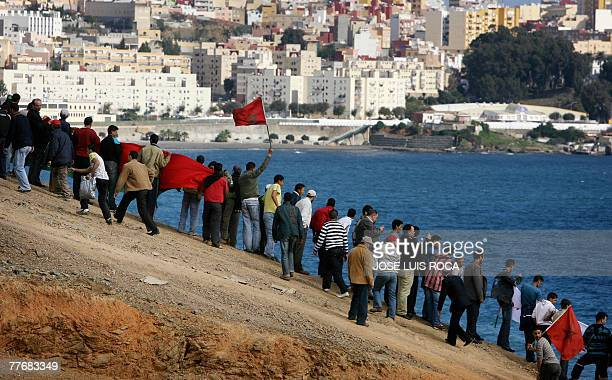 People demonstrate against the visit of Spain's King Juan Carlos to the Spanish North African enclave of Ceuta at the border between Morocco and...