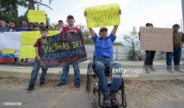 People demonstrate against Venezuelan President Nicolas Maduro and in favor of receiving humanitarian aid in Cucuta Colombia on the border with...