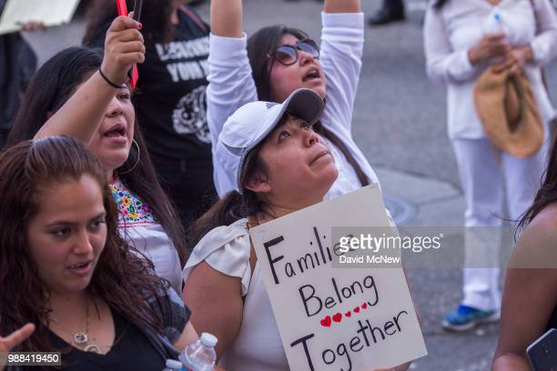 People demonstrate and call out words of encouragement to detainees held inside the Metropolitan Detention Center after marching to decry Trump...