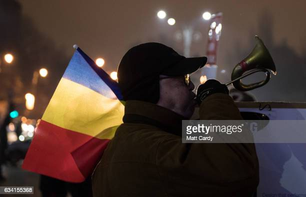 People demonstrate and protest in front of the government headquarters in Victory Square in central Bucharest on February 7, 2017 in Bucharest,...