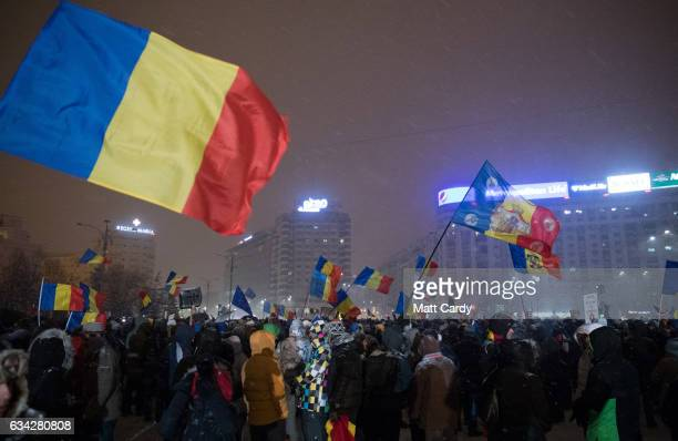 People demonstrate and protest in front of the government headquarters in Victory Square in central Bucharest on February 8 2017 in Bucharest Romania...