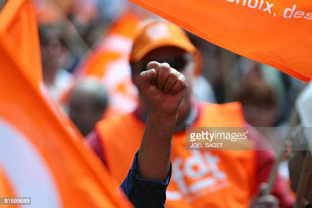 People demonstrate as part of a nationwide strike called by the two biggest unions CGT and CFDT on June 17 2008 in Paris to show opposition to...