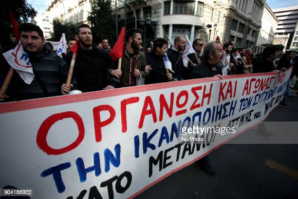 People demonstrate as part of a strike wave against changes to a 36-year-old industrial action law demanded by the country's creditors in Athens on...