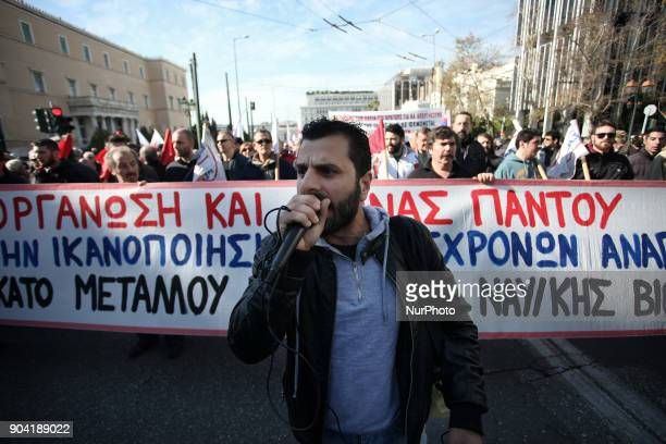 People demonstrate as part of a strike wave against changes to a 36yearold industrial action law demanded by the country's creditors in Athens on...