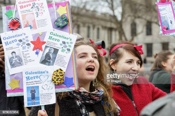 People demonstrate at a march calling for gender equality organised by Care International on March 4 2018 in London England