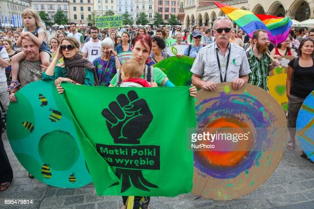 People demonstrate at the Main Square in protest against the large scale logging at Bialowieza primeval forest Krakow Poland on 12 June 2017...