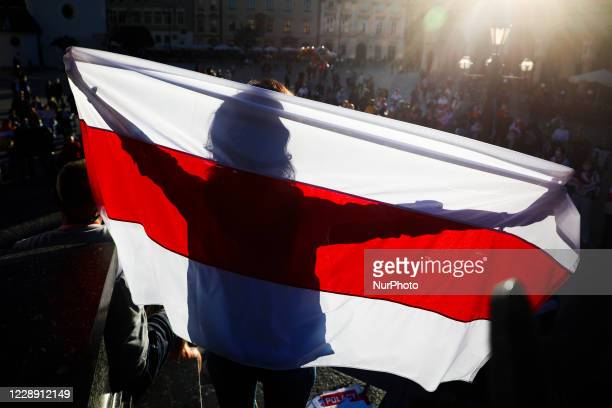 People demonstrate at the Main Square in solidarity with Belarus. Krakow, Poland on October 4, 2020. Belarusians living in Krakow and supporters...