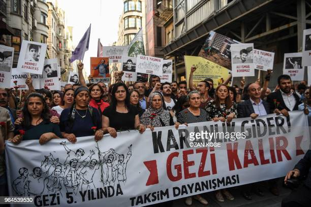 People demonstrate behind a banner reading Darkness will go Gezi will stay on May 31 2018 in Istanbul to mark the fifth anniversary of the start of...
