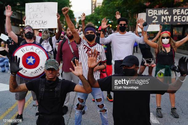 People demonstrate during a demonstration on May 31 2020 in Atlanta Georgia Across the country protests have erupted following the recent death of...