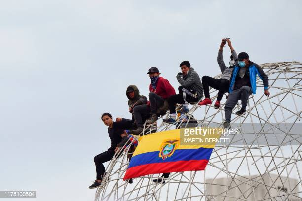 People demonstrate during a protest in Quito on October 10, 2019 as Ecuador faces protests over a fuel price hike ordered by the government to secure...