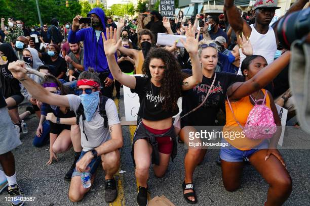 People demonstrate during a protest in response to the police killing of George Floyd on May 30 2020 in Atlanta Georgia Across the country protests...
