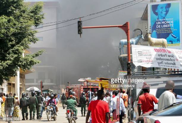 People demonstrate in central Conakry on March 12 in a day of protest against Guinea's President Thousands of people demonstrated in central Conakry...