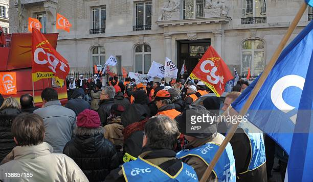People demonstrate in front of French telecommunications equipment maker Alcatel-Lucent headquarters in Paris on February 10, 2012 as Alcatel-Lucent...