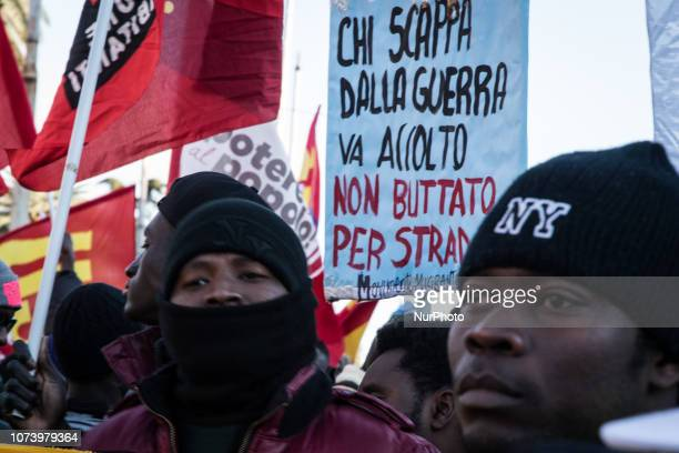 People demonstrate in Rome Saturday Dec 15 2018 Get Up Stand Up Stand Up for your rights against racism and the government's immigration policies was...