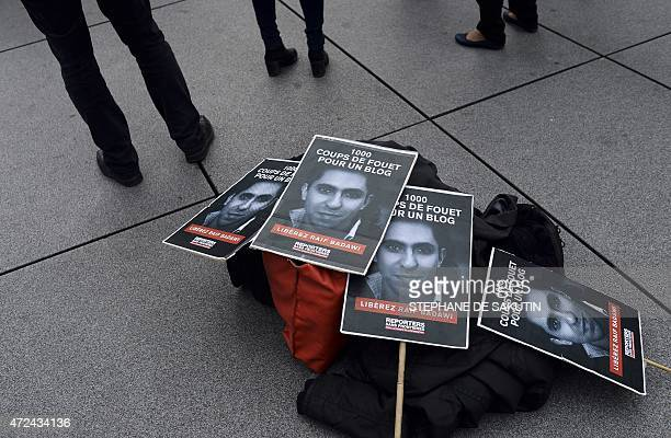 People demonstrate in support of Raif Badawi who was sentenced to 1000 lashes for insulting Islam on May 7 2015 in Paris The case of Badawi has...
