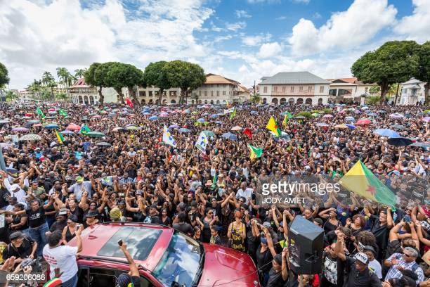 People demonstrate in support of the general strike in Cayenne on the French overseas territory of French Guiana on March 28 2017 Several thousand...