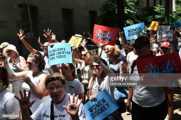 People demonstrate in Washington DC on June 28 demanding an end to the separation of migrant children from their parents US President Donald Trump...