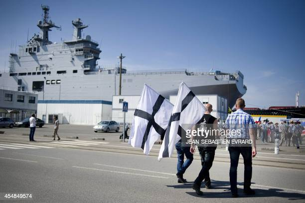 People demonstrate on September 7 2014 at the STX dockyards in the western French port of SaintNazaire against the decision of the French government...