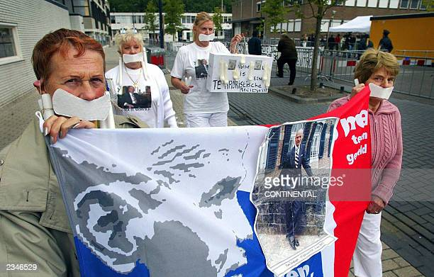 People demonstrate outside AmsterdamOsdorp courthouse 04 July 2003 where the prosecutor asked for the death penalty in the case against Pim Fortuyn's...