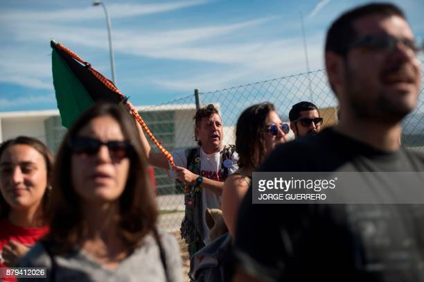 People demonstrate outside the new and yet to open jail of Archidona on November 26 where nearly 500 migrants who arrived in the country by boat last...