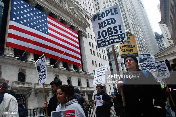 People demonstrate outside the New York Stock Exchange April 4, 2009 in New York City. Hundreds of anti-capitalist and anti-war protesters gathered...