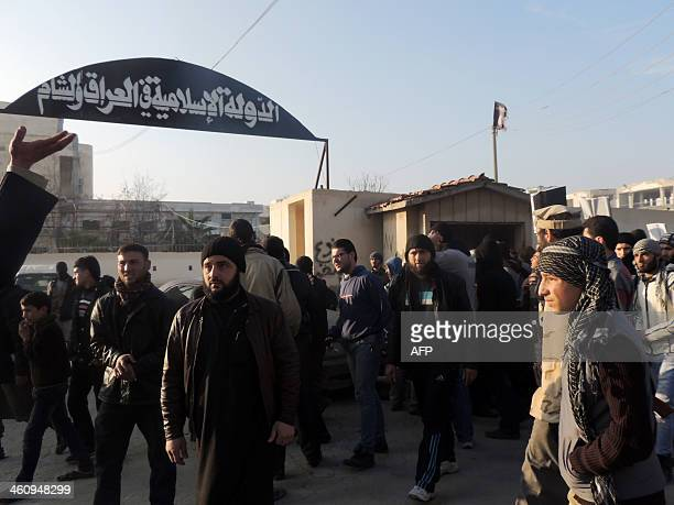 People demonstrate outside the offices of the AlQaedalinked Islamic State of Iraq and the Levant demanding that they stop fighting with the rebels on...