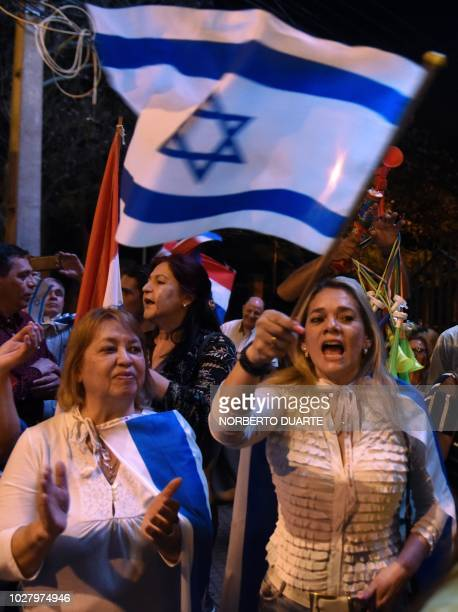 People demonstrate outside the presidential residence in Asuncion on September 06 2018 against the government's decision of moving its embassy in...