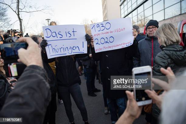 People demonstrate outside Thuringia's State parliament building with placards reading This is Thuringia 1930 first Nazi Party minister 2020 first...