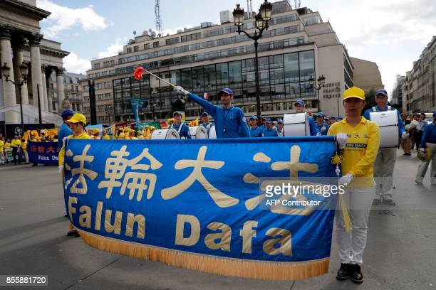 People demonstrate to support the practice of Falun Dafa in China in Paris on September 30 2017 China's officially atheist Communist authorities are...