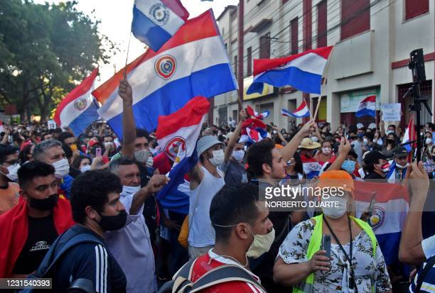 People demonstrate with Paraguayan flags against corruption and lacks in the health system, demanding the resignation of Paraguayan President Mario...