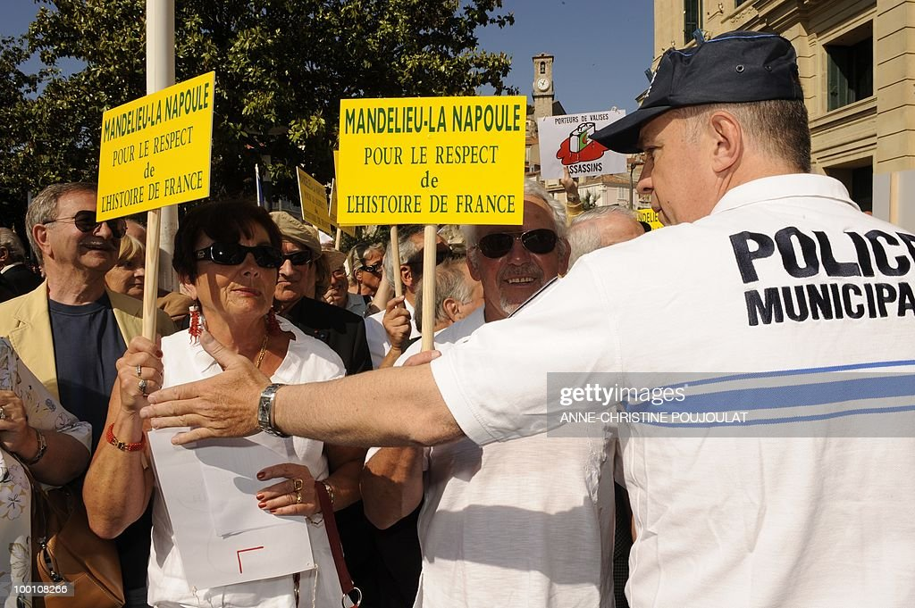 People demonstrate with placards reading 'Mandelieu La Napoule for the respect of french history' to protest against the film 'Outside Of The Law' by French-Algerian director Rachid Bouchareb, whom they accuse of distorting history, on the sidelines of the 63rd Cannes Film Festival on May 21, 2010 in Cannes. Opening with a massacre of Algerian civilians by French soldiers in the town of Setif in 1945 -- a controversial historical event which some critics say has been misrepresented -- the film is one of very few cinematic treatments of the conflict.