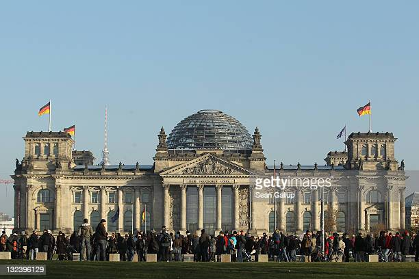 People demonstrating against the world financial system surround the Reichstag during a protest march on November 12 2011 in Berlin Germany Inspired...