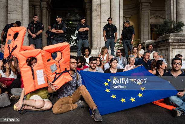 People demonstrating during a rally in Rome Italy on June 11 2018 against Italian government decision to block ports to a German NGO ship with 629...