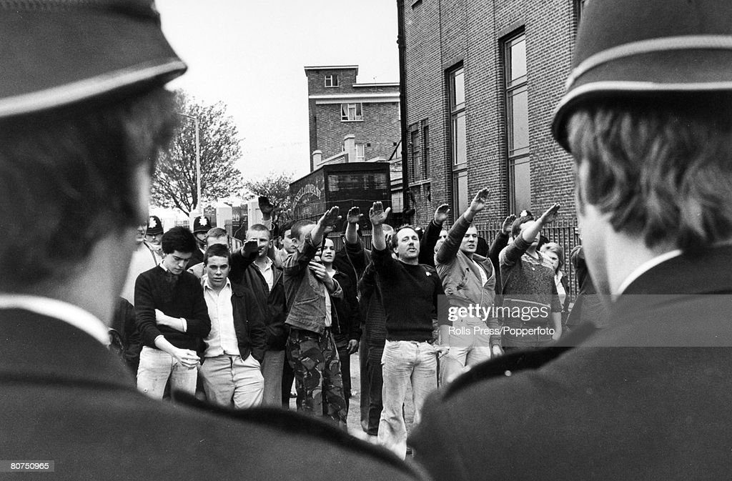 People Demonstrations. pic: 29th April 1979. London. National Front supporters give the Nazi salute through a cordon of policemen, aimed towards marchers on an anti National Front demo in East London. : News Photo