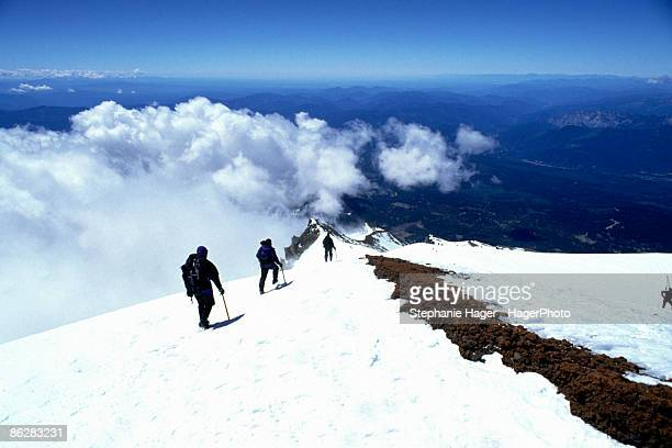 people descending mountain - mt shasta stock pictures, royalty-free photos & images