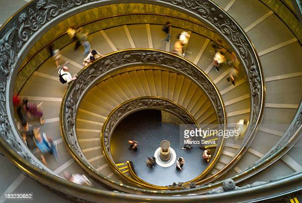 People descending the beautiful Vatican Museum spiral staircase
