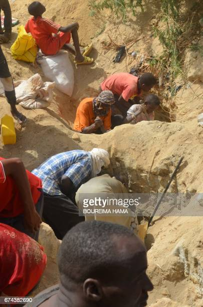 People dig as hundreds of people search gold on April 25 2017 in KafaKoira south of Niamey Hundreds of people sometimes whole families rush to...