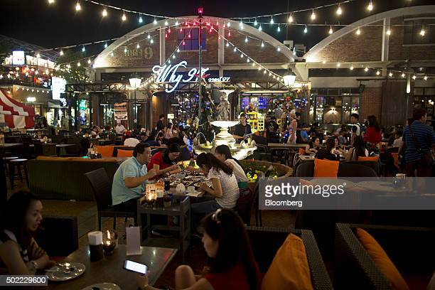 People dine at a restaurant at Asiatique The Riverfront openair mall in Bangkok Thailand on Friday Dec 18 2015 Thai economic indicators have shown...