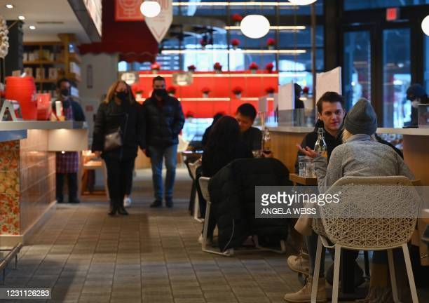 People dine at a restaurant at Hudson Yards on February 12, 2021 in New York City as restaurants can reopen for indoor dining at 25 percent capacity....