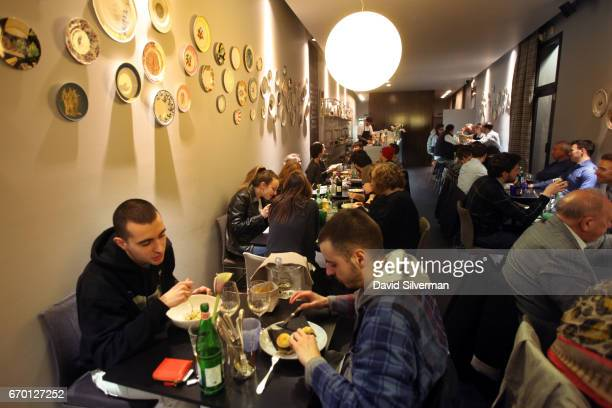 People dine at Franceschetta 58 Italian chef Massimo Bottura's second restaurant on March 27 2017 in Modena Italy Franceschetta 58 is an informal...